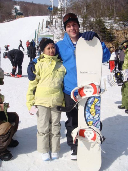 Kristina's friend Jeanette is smaller than Russell's snowboard.