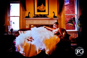 Bride posing on a couch.