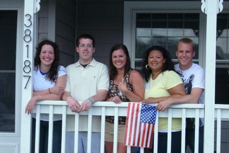 On the porch of the Emery's being patriotic.