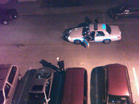 Cops about to tow away a car whose alarm was blaring all night long.