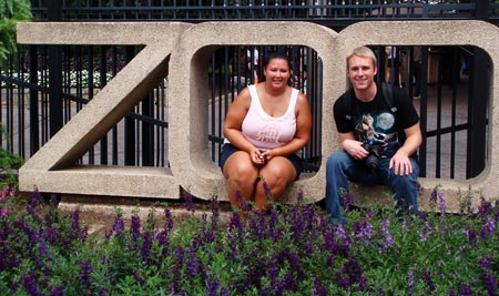 Kristina and Russell sitting in the DC zoo sign