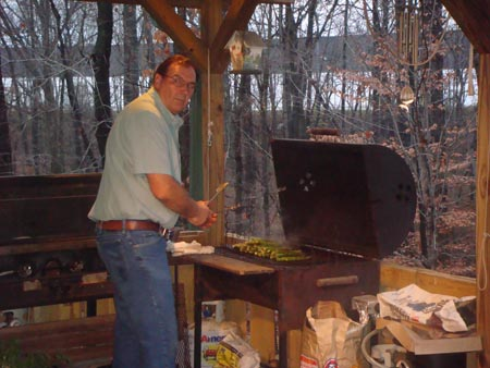 Mr. Naude cooking vegetables out on the grill.