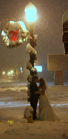 Linday and Luke kissing in the snow on their wedding day.